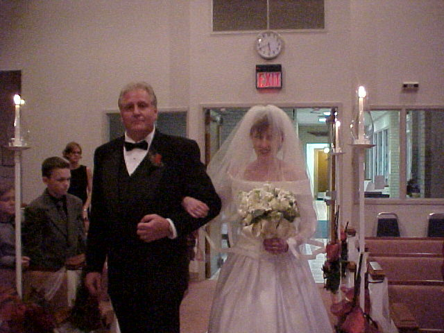 John Nath escorts his daughter down the aisle